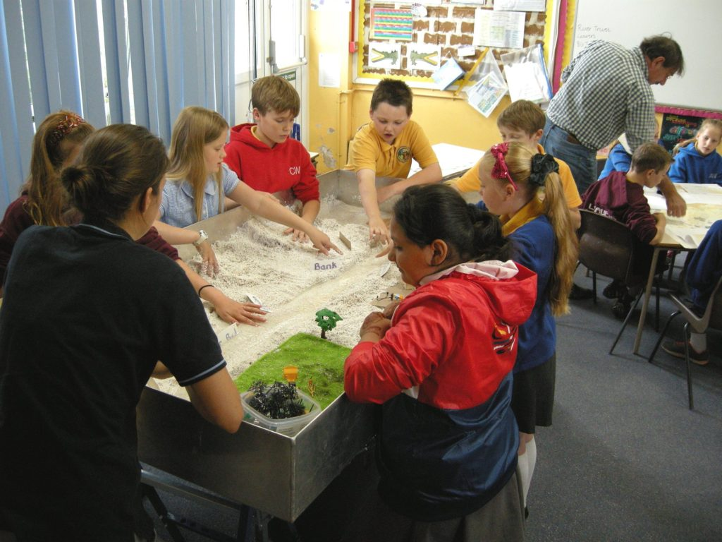 Students at Bardsey school working with the Educational River Table